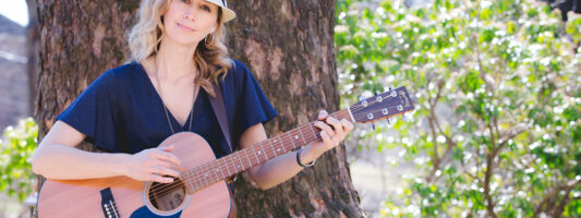 Kira Willey guitar outside